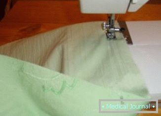 Process the edges on a sewing machine. It can be done on overlock, zigzag or hemmed bent edges ткани.